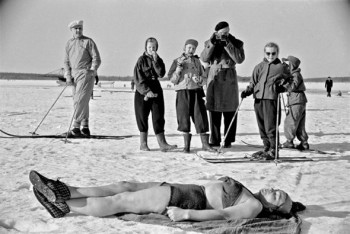 Suntanning: this swimmer has dipped herself in icy water and pretends it's time for suntanning. A sunny winter day in Helsinki, 1952. Photo: Väinö Kannisto